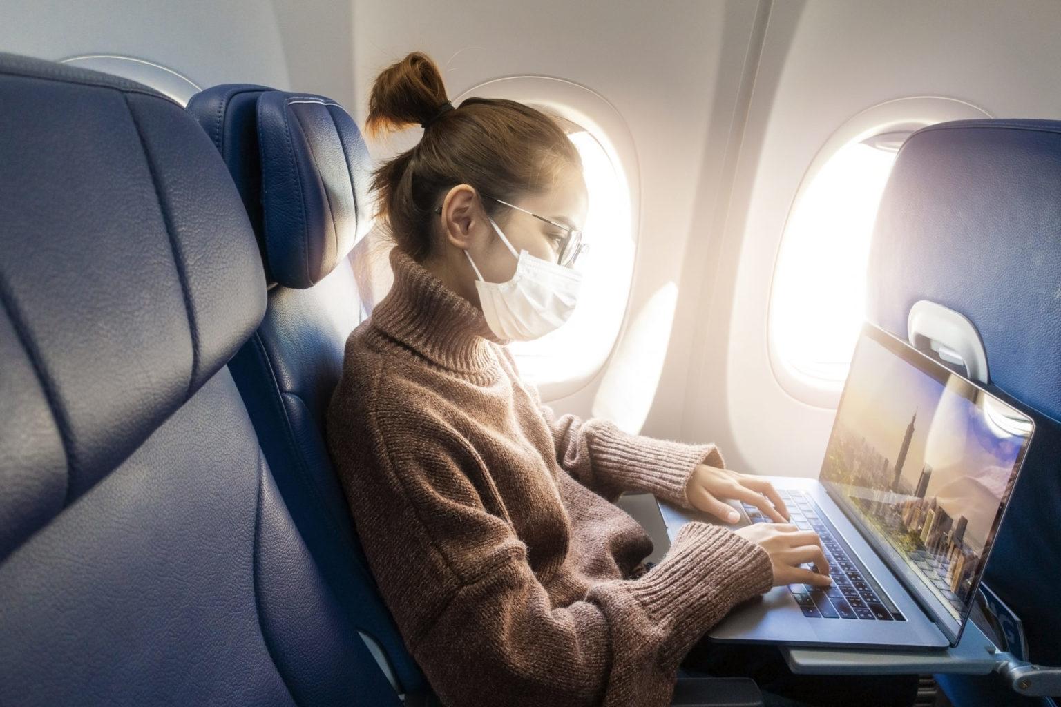 female business traveller on plane